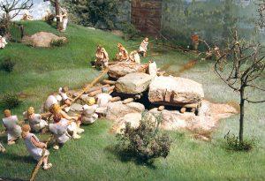 Steintransport für den Bau eines jungsteinzeitlichen Großsteingrabs. Modell aus dem Musée des Mégalithes de Wéris, 1994 (Quelle: https://commons.wikimedia.org/wiki/File:Maquette-dolmen-weris.jpg?uselang=de).